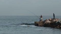 Egyptians fishing in the Mediterranean near Alexandria - stock footage