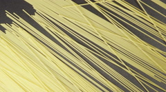 A Spaghetti roll on a black table - diagonal (top view) Stock Footage