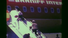 1976: Boarding Braniff International airways staircase outdoor jet. COLON, Stock Footage