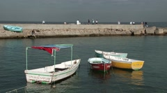 Small fishing boats bob in the water, Alexandria Egypt - stock footage