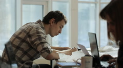 Young man create drawing in light room with colleagues Stock Footage
