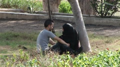 Young Egyptian couple in a park in Alexandria - stock footage