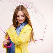 Woman wearing waterproof coat under umbrella Stock Photos