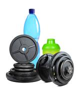 Dumbbells with protein shaker Stock Photos