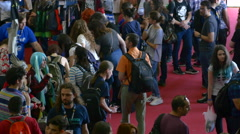 Aerial View Of A Crowded Stand At Convention, People Walking By Stock Footage