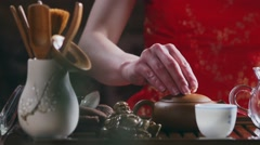 pour tea leaves with water - stock footage