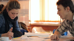 Two students discuss task for lesson of architecture using schemes Stock Footage