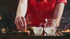 Pouring tea into a pitcher Stock Footage