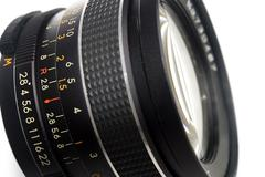 Photography lens over blue - stock photo