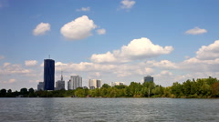 Skyline of the Danube City at  Danube Island seen from the Danube river - stock footage