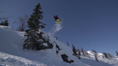 Snowboarder Jumping In Mountain In Winter Day Stock Footage