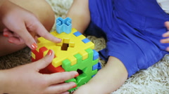 Children conundrum in child hands Stock Footage