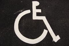 Handicap sign on asphalt Stock Photos