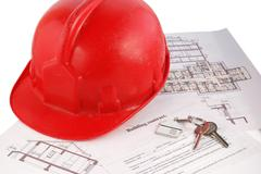Keys on building contract - stock photo