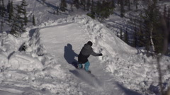 Snowboarder Jumping On A Sunny Winter Day Stock Footage