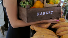Young woman shopping at the local Farmers market. Stock Footage