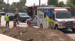 Car accident and crash in city intersection with ambulance on scene - stock footage