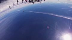 Professional skydivers parachuting, make big formation. Sunny day. Extreme stunt - stock footage