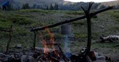 Boiling Water in a Tourist Pot Above the Fire Stock Footage