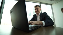 very emotional businessman enjoys good news,to receive e-mail, stocks rise in - stock footage