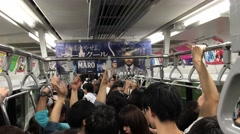 Crowded subway train at rush hour tokyo Stock Footage