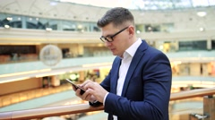 the representative of the company, businessman talking on mobile in a major - stock footage