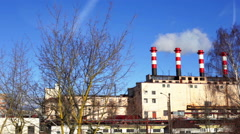 Tall chimneys in blue sky, air pollution Stock Footage