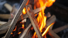 Bonfire with a strong flame in form of a hut in which puts board in winter Stock Footage