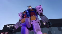 A life size Gundam is displayed at Gundam Front Stock Footage