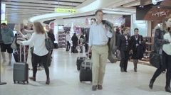 Airport crowd international travelers rush Stock Footage
