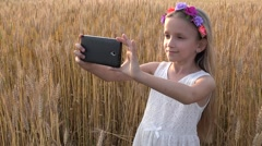 4K Young Girl Making Selfie with Tablet, Child, Kid Playing in Wheat Field Stock Footage