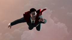 Businessman flying as a Superman in a red Cape on the sky background Arkistovideo