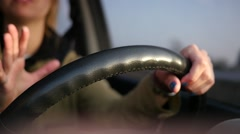 Female driving a car holding a steering wheel Stock Footage