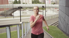 Athletic woman running on stairs - interval training - stock footage