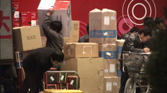 Unloading truck, boxes, computers, China Stock Footage