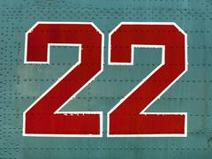 Red 22 numbers on aircraft fuselage close up. Stock Photos