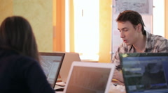Students work for project in classroom using laptops - stock footage