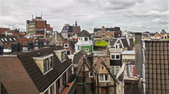 Clouds passing over amsterdam neighborhood old houses time lapse overcast 4k Stock Footage