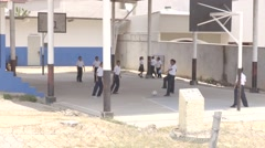 Boys Playing Indoor Soccer on Basketball Court - stock footage