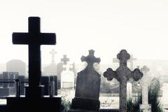 cemetery with tombs and fog - stock photo