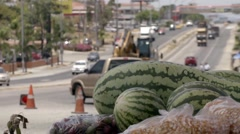 Watermelons in Foreground of Traffic on Street Stock Footage