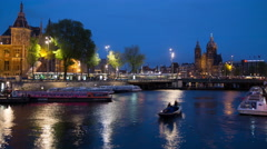 Downtown Amsterdam Netherlands canal boats trams blurred movement evening 4k Stock Footage
