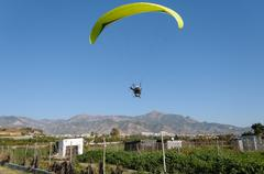 Yellow motor- driven paraglider - stock photo