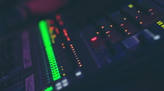 Audio engineer operating mixing console with hands. RAW video record Stock Footage