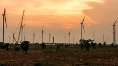 Time lapse - Wind turbine power generator at twilight-zoom in - stock footage