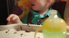 Baby Caucasian Boy sitting In High Chair Eating with His Mom Stock Footage