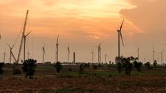 Time lapse - Wind turbine power generator at twilight-zoom out - stock footage