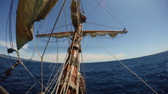 On nose of replica vintage ship sailing in open sea - stock footage