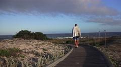 Asilomar Scenic Pacific Grove, Monterey coastline walk to the beach Stock Footage