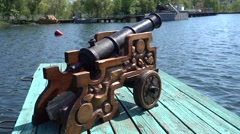 Canon on river wharf Stock Footage